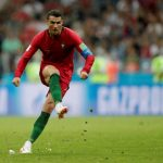 Ronaldo's hat trick denies Spain a win – Russia wins opening game